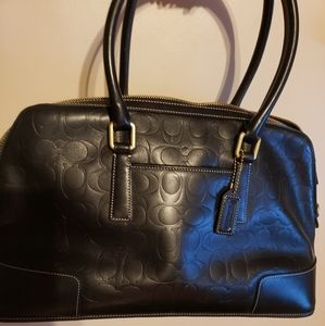 Coach signature embossed all leather purse